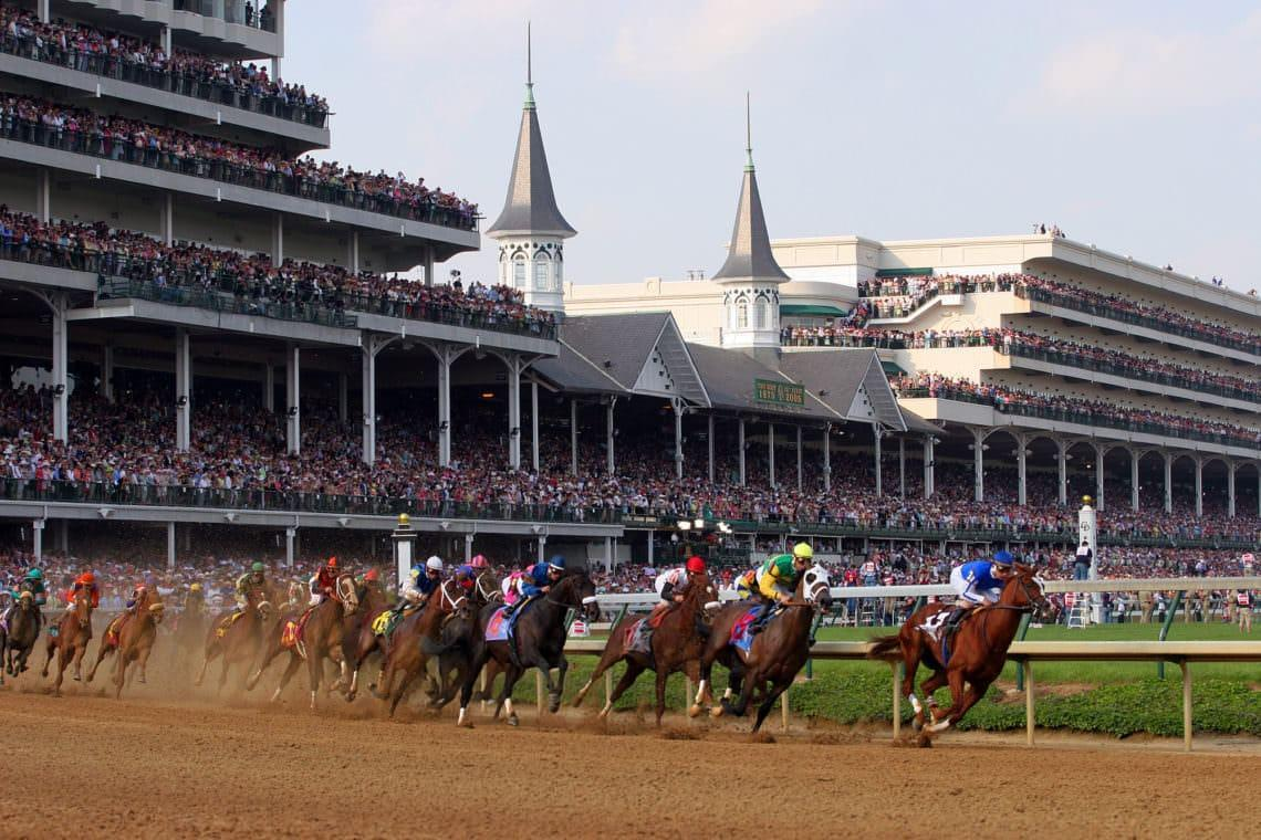 07 May 2005, Louisville, Kentucky, USA --- The field of 20 horses round the first turn during the 131st Kentucky Derby at Churchill Downs. Winner, Giacomo, ridden by Mike E. Smith, is on the far left in the pink and green silks. --- Image by © Steve Boyle/NewSport/Corbis